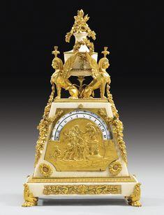 Pendule aux sphinges à cercles tournants en bronze doré et marbre blanc d'époque Louis XVI, vers 1790