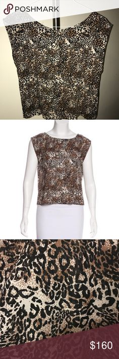 Alice + Olivia Leopard Print Silk Top Alice + Olivia silk sleeveless crop top with crew neck, leopard print throughout and exposed gold-tone zip closure at nape. Fabric: 96% Silk, 4% Spandex Alice + Olivia Tops Blouses