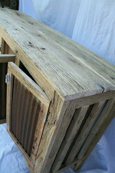 Rustic, distressed, reclaimed barn wood and tin cabinet. DIY collapsing barns all over the south.