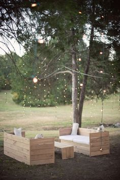 I think I found the solution to my patio furniture dilema. I wonder if we could repurpose old pallets? The lights in the tree are pretty too! Someone tell Chris his wife wants these.