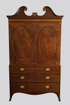 14102. A fine George III mahogany linen press converted for hanging with pediment top, with satinwood inlaid freeze oval panels with tulipwood banding with shaped apron and splay feet. Circa 1790. Exhibitor: Guy Dennler Antiques - The Art & Antiques Fair Olympia