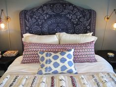 At Home: In the Bedroom. Eclectic and bohemian with great bedside sconces.