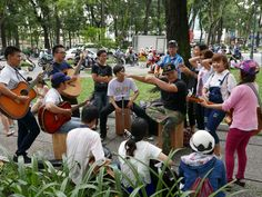 More music in the park – The 30-4 Park in Ho Chi Minh City (Saigon), Vietnam. The park seems to be a very popular meeting place for people on a Sunday morning. There were people playing music and singing, people just sitting and talking, and some people having their breakfast. #30-4Park #HoChiMinhCity #HCMC #Saigon #Vietnam #everybodystreet #lensculture #streettog #SEAsia #Traveling #Travelling #Wandering #Wanderer #travel