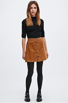 Khaki skirt with a basic top