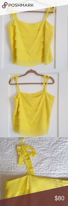 Feraud Yellow Ribbon 100% Silk Tank US Sz 14 Absolutely gorgeous vibrant lemon yellow, silk layered tank, slightly cropped, delicate ribbon tie straps. New with tags, has very tiny flaw as pictured in sixth photo. The bottom edge of one of the front layers has a slight imperfection that is not very noticeable. Back zip. Labelled size is UK 18, USA 14. Measures 21 inches across, 15 inches in length not counting straps which can be tied shorter or longer. Feraud Tops Blouses