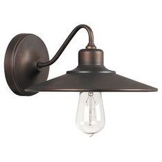 """A sleek silhouette and Edison-inspired bulb lend this wall sconce industrial appeal-display it in your dining room or master suite for eye-catching style.  Product: Wall sconceConstruction Material: MetalColor: Burnished bronzeAccommodates: (1) 75 Watt medium base bulb - not includedDimensions: 5.75"""" H x 10"""" W x 11.5"""" D"""