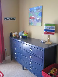Paint the dresser instead of the wal a bright color. easier to change colors and not so overwhelming