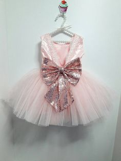 +For+years+we+have+been+designing+everything+with+sequins+and+glitter.+This+year+we+have+had+a+few+sequin+bow+dresses,+some+with+big+sequined+bows+but+this+is+by+far+the+most+stunning+dress+with+the+biggest+bow+EVER!+ This+sparkly+and+girly+dress+is+available+in+these+color+choices: Light+pin...