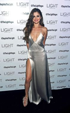 70 of Selena Gomez's style moments: Selena is pictured wearing a silver silk low plunge slipdress with a sexy side slit