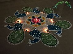 Rangoli Designs by Uma Raja Rangoli Designs Latest, Rangoli Designs Flower, Rangoli Border Designs, Rangoli Designs With Dots, Rangoli Designs Diwali, Flower Rangoli, Beautiful Rangoli Designs, Peacock Rangoli, Indian Rangoli