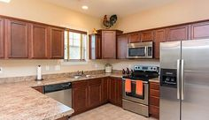 157 Hawks Point Road Jacksonville, NC 28540 by JG Homes, INC  | The cook of the family will love the open kitchen with plenty of counter and cabinet space, as well as the stainless steel appliances.