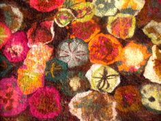 Bloemen vilten op plat vlak