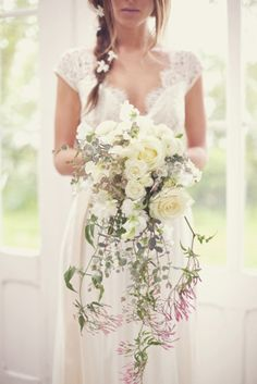 I always assumed I would have a posie bouquet on my wedding day. Then I visited a wedding fair and fell in love with this bouquet! I think it's dreamy Bouquet En Cascade, Cascading Bridal Bouquets, Wedding Bouquets, Trailing Bouquet, Wedding Flowers, Cascading Flowers, Trailing Flowers, Beautiful Flowers, Hanging Flowers