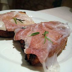 Lardo Rosemary Bruschetta - grill bread slices in the oven on both sides, put some lardo slices on each, a few seconds back in the oven and garnish with some rosemary