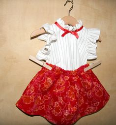 Your baby girl needs a new dress  for Christmas!  Here it is: Red velvet with ocher drawings skirt and white striped top with red satin ribbon: perfect for the Holy night!