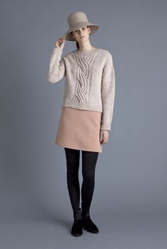 Samuji - Fall 2015 Ready-to-Wear. Light-colored top and skirt with black stockings and boots.