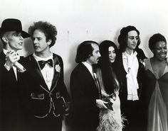 Backstage at the 17th Annual GRAMMY Awards in 1975, David Bowie, Art Garfunkel, Paul Simon, Yoko Ono, John Lennon and Roberta Flack all hang out