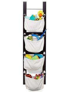 A Family Room for Everyone: Toy Storage: Hang Up (via Parents.com)