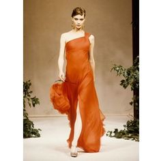 Adding some citrus and spice to the catwalk, @shalomharlow wears a flowing tangerine gown on the Haute Couture Spring/ Summer 1994 runway. #OneDressADay