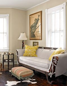 After Finished Living Room: White plantation shutters take the place of heavy drapes. The yellow pillows—adorning a late-Victorian sofa McCarty inherited from her grandmother—are from the designer's home accessories collection (maryjanemccarty.com).