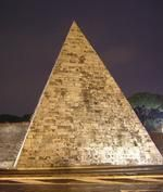 Pyramid of Cestius...... As well known to Romans as the Colosseum, the Pyramid of Cestius is relatively unknown to first-time visitors to Rome. The pyramid was built approximately 18 BC, during a time when the Romans were enjoying a fashion for all things Egyptian, for a tomb for Gaius Cestius. Later, the Romans built the Aurelian Wall right around the pyramid, using it as part of the fortification. Today, the pyramid backs the quiet green oasis of the Protestant Cemetery.Photo Jona Lendering.