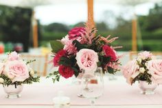 Floral arrangements in pink & green. #LillyPulitzer #SouthernWeddings