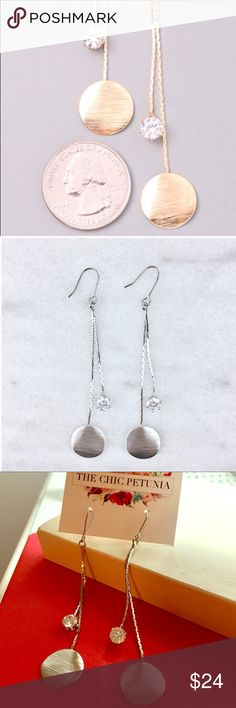 Silver and crystal dangling earrings Silver plated 2 inch long earrings. Disc and crystal accents from the Chic Petunia. A customer favorite. The Chic Petunia Jewelry Earrings