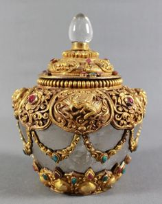 A SOUTHEAST ASIAN ROCK CRYSTAL GILT BRONZE & JEWEL ENCRUSTED COVERED VESSEL. 20TH CENTURY