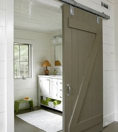 barn door to separate the shower/toilet from the vanity area...more durable than a pocket door