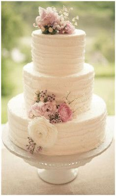 Spring wedding classic cake...change up flowers to Fall color scheme