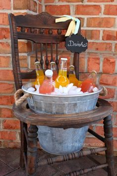 Repurpose an old vintage chair into a pretty drink stand using a galvanized bucket! Perfect for entertaining, parties or bridal showers!