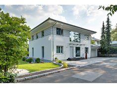 Walmdach 208 - #Einfamilienhaus von LUXHAUS Vertrieb GmbH & Co. KG | HausXXL #Stadtvilla #modern #Walmdach