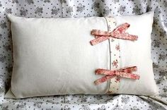 another pretty pillow DEB: I have a huge love for buttons and bows. They step almost everything up a notch or more.