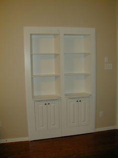Double hidden door with three shelves and two cupboards