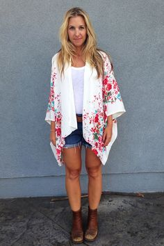 Woman Wearing a Kimono Cardigan and Jean Shorts