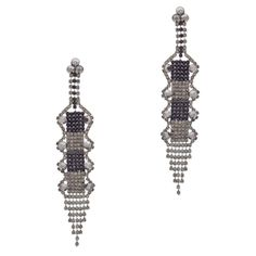 """Love this! Found it on Journey Accessories The Ava earrings are the perfect choice for your next evening out. This sleek and modern drop pair features exquisite black rhinestones alongside silver and clear CZ's. Art deco-inspired and sophisticated, Ava's touch of drama is just what your LBD calls for.  - Silver tone metal, rhinestone, CZ's - 5"""" long - Post back for pierced ears  $36"""