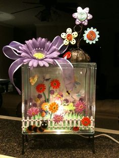 Flowers and bugs glass block using items from Michael's (scrapbook paper) and Hobby Lobby (scrapbooking stickers floral ribbon spring & garden photo holder) Painted Glass Blocks, Decorative Glass Blocks, Lighted Glass Blocks, Glass Cube, Glass Boxes, Glass Jars, Summer Crafts, Holiday Crafts, Cubes