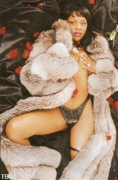 More of Lil Kim's awesome Fox Coat...