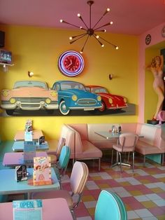 American diner décor - retro furniture from the 50s, pink and mint colour combo, and statement ceiling light