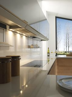 New uses for traditional materials: the use of glass in the wall units provides a lightweight feeling to the whole kitchen.ae 📧 info 📲 04 551 6761 🏢 Suite 31 C, iRise Tower, Tecom, Dubai Kitchen Dubai, Aesthetic Solutions, New Uses, Kitchen Interior, Design Kitchen, Interiores Design, Kitchen Dining, Minimalist, Ceiling Lights