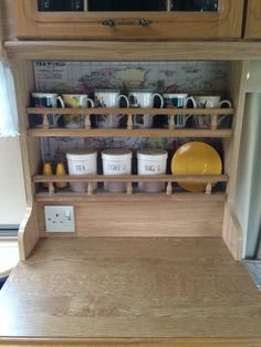 line the back of the cupboards/shelves with maps!