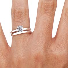 For the minimalist bride, sometimes the less diamonds a ring has, the better. To meet this desire, I have included a classic engagement and wedding ring set with a simple metal band and a solitary diamond in this album. This style is 2 millimeters wide and is available in platinum, white gold, and yellow gold from @Brilliant Earth.
