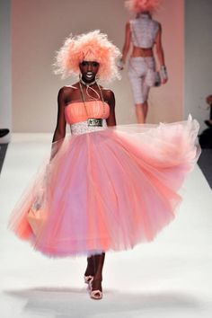 Betsey Johnson's brand of irresistible fun sauntered down the runway sporting pink hair, leopard print, and a whole lot of sass AND a whole lot of PINK ♥