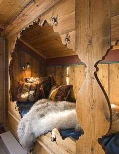 Cozy and warm rustic sleeping nook.  Perfect place to watch it snow.