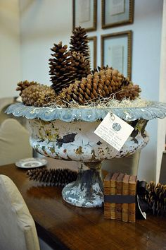 Pine cones with excelsior in metal urn. from Mrs. French blog.