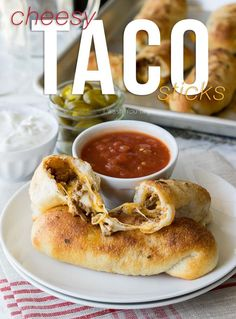 These super simple Cheesy Taco Sticks are buttery breadsticks filled with taco meat and lots of cheese! Perfect for snacking or watching the big game! Ever since I made those crazy delicious Cheesy Pizza Sticks, Mexican Dishes, Mexican Food Recipes, Beef Recipes, Dinner Recipes, Cooking Recipes, Recipies, Top Recipes, Appetizer Recipes, Holiday Recipes