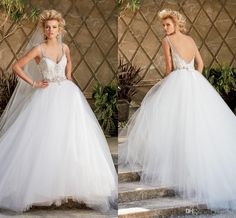 Ballgown Wedding Dress Stunning Ruched Tulle Ball Gowns Wedding Dresses 2015 Crystal Beaded Applique Bodice Spaghetti Straps Sexy Backless Garden Bridal Gowns Ah07 Wedding Dresses Cheap From Engerlaa, $162.81| Dhgate.Com