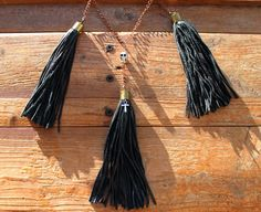 Made from real leather and has been recycled (its eco friendly) which I think adds to the post apocalyptic beauty, in a middle tassel I added ankh