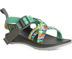 Chaco Kids: ZX1 Ecotread Little Kid/Big Kid (Camper Turquoise) The Chaco Kid's ZX/1 Ecotread sport sandal is a girly, yet sporty sandal that's ready for action. This waterproof outdoor style offers a completely anatomically contoured footbed with nylon adjustable strap in the Custom Adjust'em system offering a secure fit around kids' feet. Cool graphic multi-colored pattern adds a spark of fun. Designed by a Podiatrist this shoe offers exceptional support and promotes a healthy overall body…