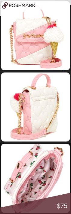 """Betsey Johnson Pink & White Cross-body Cute Betsey Johnson pink & white crossbody  with quilted heart design. Cute ice cream with cherry on top key ring that is removable. Long chain strap and a handle. Removable top handle with inner snap button closure. Front flap with snap button closure. Printed pretty lining. Adorable faux leather mini cross-body bag. Size approximately, 2"""" handle drop, 24"""" strap drop, purse size 7.5""""H x 5.5""""Wx2""""D. NWT. Betsey Johnson Bags Crossbody Bags"""
